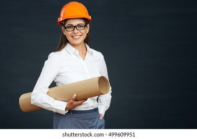 Young woman architect holding blueprint. Smiling woman real estate manager. Black background.