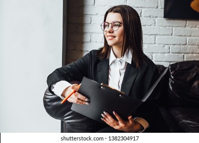 Young woman arranged for work at modern cafe! Portfolio. Business time!