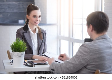 Young woman arriving for a job interview. Business people talking in modern office. colloquy dream job