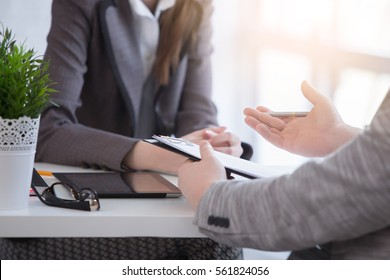 Young woman arriving for a job interview. Business people talking in modern office. colloquy dream job close up.