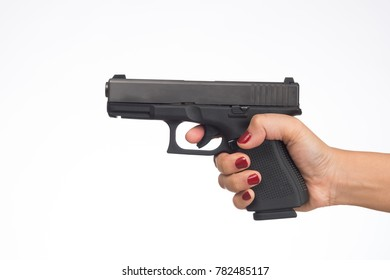 young woman asian girl holding a gun aiming at the gun white background