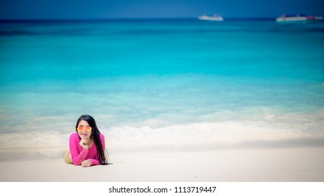 young woman asian has relax time  on the beautiful beach in puket, thailand.