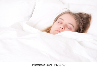 a young woman asleep in her bed