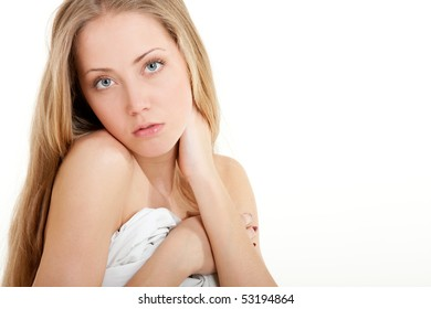 Young woman awaking. Isolated over white background.