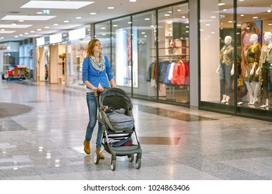 Young woman with baby during shopping