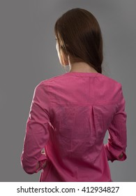 young woman back view. Dark gray background