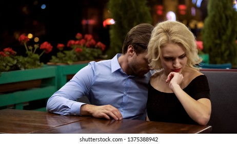 Young woman in bad mood, reluctant to talk to boyfriend, upset and jealous