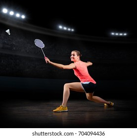 Young woman badminton player (in sports hall version)