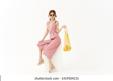 young woman with bag eco place free cube