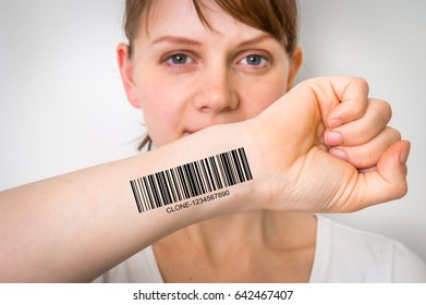 Young woman with barcode on her hand - genetic clone concept
