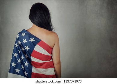 Young woman with bare back with american flag