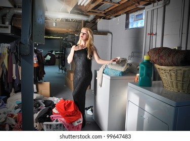 A young woman in in the basement doing laundry and chores while pretending to be in a stage play and acting with a spotlight on her. Use it for an art or