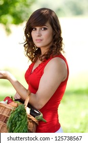 Young woman with basket filled fresh vegetable