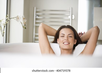 A young woman in the bath