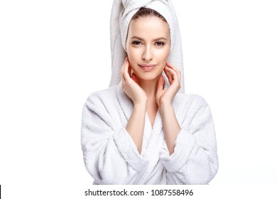 Young woman in a bathrobe and towel on her head, spa and care portrait, clean natural face, portrait on a white background isolated