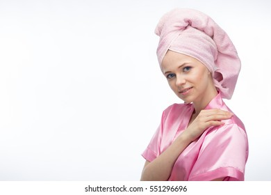 Young woman in bathrobe and towel on head