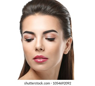 Young woman with beautiful eyebrows on white background