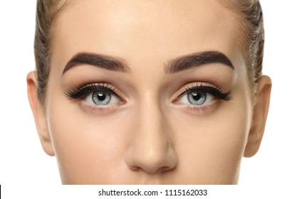 Young woman with beautiful eyebrows on white background, closeup