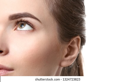Young woman with beautiful eyebrows on white background, closeup - Shutterstock ID 1324723823