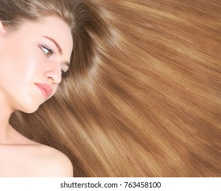 Young woman with beautiful long hair of caramel color