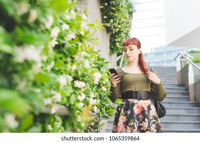 young woman beautiful outdoor using smart phone - technology, social network, communication concept