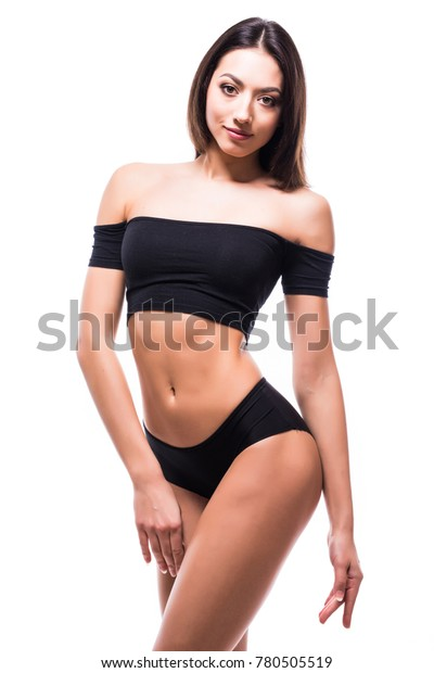 Young woman with beautiful slim perfect body in bikini isolated white background