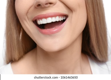 Young woman with beautiful smile, closeup. Teeth whitening