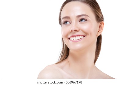 Young woman beauty face portrait. Beautiful model girl with perfect fresh clean skin and natural make up. Skin care concept isolated on a white background.