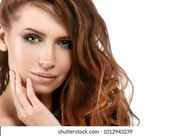 Young woman with beauty skin and beauty hairstyle isolated on white. Studio shot.