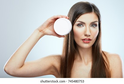Young woman beauty style portrait with jar face anti wrinkles cream.