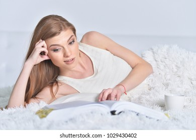 young woman in bed