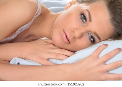 Young woman in bed, awake