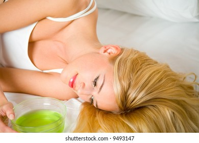Young woman at bedroom with hair masque
