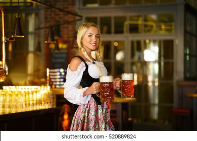 Young woman with beer in bar