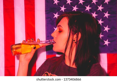 young woman with beer (red flash)