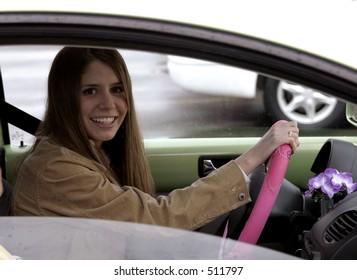 Young woman behind wheel of car