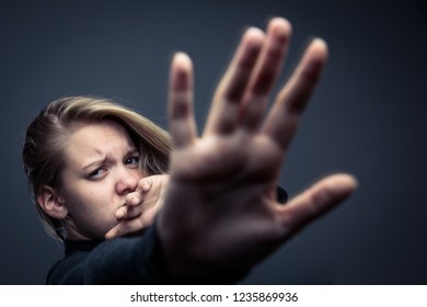 Young woman being a domestic violence victim