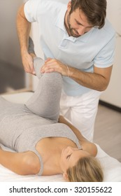 young woman being manipulated by physiotherapist