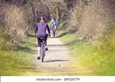 Young woman bicycling in the forest