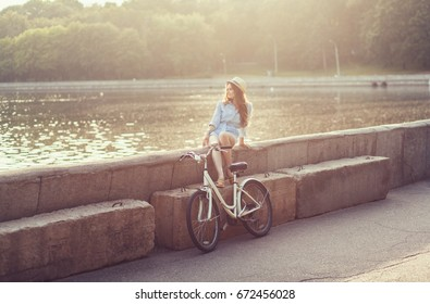 Young woman with bike enjoy summer vacation