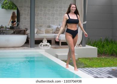 Young woman in a bikini.