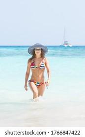 Young woman in bikini comes out of the sea. Tachai island, Thailand