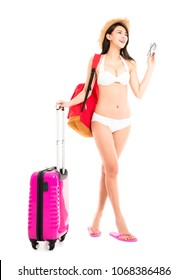 young woman in bikini posing with travel suitcase
