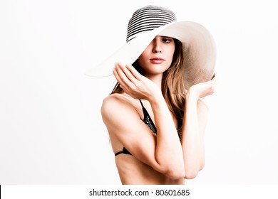 young woman in bikini wearing hat, portrait, studio shot