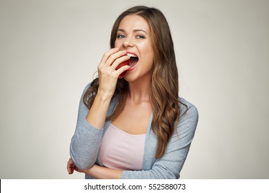 young woman bite red apple. healthy teeth. isolated portrait
