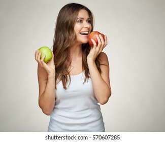 Young woman bites apple. isolated portrait.