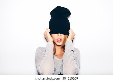 young woman in black beanie . White background, not isolated