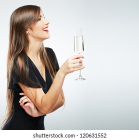 Young woman black dress . Beautiful model portrait isolated over studio background hold wine glass.