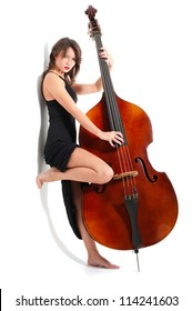 Young woman in black dress play double bass isolated on white