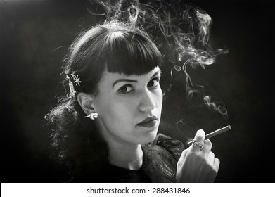 Young woman in black holding cigar and smoke